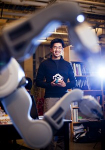 VANCOUVER, B.C .: NOVEMBER 20, 2013 -- 3rd year HRI PHD student Matthew Pan interacts with a PR2 robot in a lab on UBC campus in Vancouver, British Columbia on November 20, 2013. (BEN NELMS for National Post) - Story for T. Hopper -